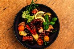 Gegrillter Oktopus auf Salat